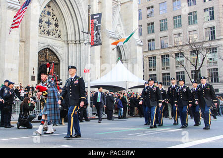 Lt. Col. Sean Flynn, battalion commander of the New York National Guard's 1st Battalion 69th Infantry Regiment, 'The Fighting 69th,' left, leads his battalion past St. Patrick's Cathedral while marching up Fifth Avenue during the 255th St. Patrick's Day Parade in New York City. (U.S. Navy photo by Lt. Matthew Stroup/released) - Stock Photo