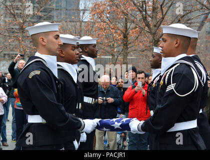 160315-N-LV695-015 NEW YORK (March 15, 2015) U.S. Navy Ceremonial Guardsmen conduct a flag presentation at the 9/11 Memorial Museum. The Ceremonial Guard is the Navy's most prestigious unit and conducts ceremonies for Presidential inaugurations, distinguished visitors, and burials at Arlington National Cemetery. (U.S. Navy photo by Mass Communication Specialist 2nd Class Destiny Cheek/Released) - Stock Photo