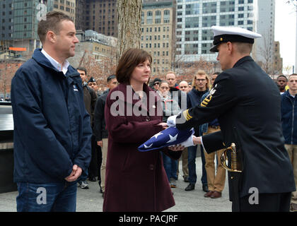 160315-N-LV695-068 NEW YORK (March 15, 2015) Senior Chief Operations Specialist Ryan King, assigned to U.S. Navy Ceremonial Guard, hands off a flag to show support for the staff at the 9/11 Memorial Museum. The ceremonial guard is the Navy's most prestigious unit and conducts ceremonies for presidential inaugurations, distinguished visitors, and burials at Arlington National Cemetery. (U.S. Navy photo by Mass Communication Specialist 2nd Class Destiny Cheek/Released) - Stock Photo