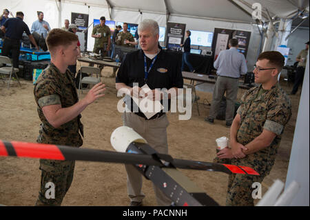 CAMP PENDLETON, Calif. (Apr. 26, 2017) Lee Mastroianni, program officer at the Office of Naval Research (ONR), talks to Marines about the prototype LOCUST (Low-Cost Unmanned Aerial Vehicle Swarming Technology) tube-launched UAVs during the Ship-to-Shore Maneuver Exploration and Experimentation (S2ME2) Advanced Naval Technology Exercise (ANTX) 2017 at Marine Corps Base Camp Pendleton, California. S2ME2 ANTX brings industry, academia, and the Naval Research Development Establishment (NR&DE) together to demonstrate emerging technology and engineering innovations that address priority Navy and Mar Stock Photo