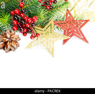 Christmas compositionon with green fir branches, red holly barries, red and golder stars and  fir cone isolated on a white background - Stock Photo
