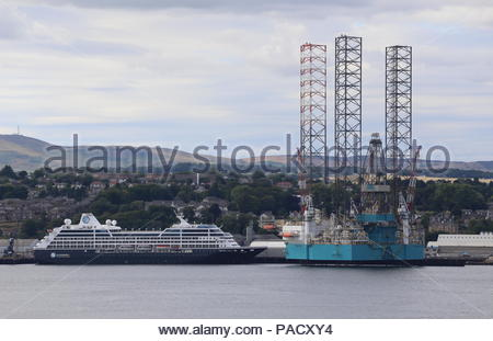 Dundee, UK. 21st July 2018. Cruise ship Azamara Journey and oil rig Rowan Norway at Port of Dundee on warm but overcast day.  © Stephen Finn/Alamy Live News - Stock Photo