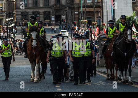 Glasgow, Renfrewshire, UK. 13th July, 2018. Members of the SDL seen escorted away by police.Protest in Glasgow against Donald Trump's visit to England and Scotland which resulted in a confrontation between the SDL and anti-Trump protesters. Credit: Stewart Kirby/SOPA Images/ZUMA Wire/Alamy Live News - Stock Photo
