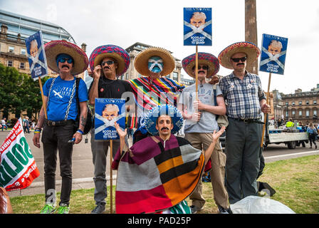 Glasgow, Renfrewshire, UK. 13th July, 2018. A group of protesters seen posing holding posters.Protest in Glasgow against Donald Trump's visit to England and Scotland which resulted in a confrontation between the SDL and anti-Trump protesters. Credit: Stewart Kirby/SOPA Images/ZUMA Wire/Alamy Live News - Stock Photo