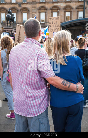 Glasgow, Renfrewshire, UK. 13th July, 2018. A couple looks at the stage during the event.Protest in Glasgow against Donald Trump's visit to England and Scotland which resulted in a confrontation between the SDL and anti-Trump protesters. Credit: Stewart Kirby/SOPA Images/ZUMA Wire/Alamy Live News - Stock Photo