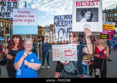 Glasgow, Renfrewshire, UK. 13th July, 2018. A group of protesters with their posters during the event.Protest in Glasgow against Donald Trump's visit to England and Scotland which resulted in a confrontation between the SDL and anti-Trump protesters. Credit: Stewart Kirby/SOPA Images/ZUMA Wire/Alamy Live News - Stock Photo