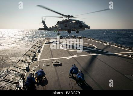 160328-N-FQ994-034 MEDITERRANEAN SEA (March 28, 2016) A Turkish Navy S-70B Seahawk lands aboard USS Porter (DDG 78) March 28, 2016. Porter, an Arleigh Burke-class guided-missile destroyer, forward-deployed to Rota, Spain, is conducting a routine patrol in the U.S. 6th Fleet area of operations in support of U.S. national security interests in Europe. (U.S. Navy Photo by Mass Communication Specialist 3rd Class Robert S. Price/Released) - Stock Photo