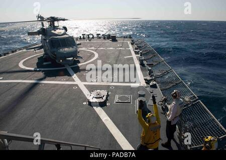 160328-N-FQ994-152 MEDITERRANEAN SEA (March 28, 2016) A Turkish Navy S-70B Seahawk lands aboard USS Porter (DDG 78) March 28, 2016. Porter, an Arleigh Burke-class guided-missile destroyer, forward-deployed to Rota, Spain, is conducting a routine patrol in the U.S. 6th Fleet area of operations in support of U.S. national security interests in Europe. (U.S. Navy Photo by Mass Communication Specialist 3rd Class Robert S. Price/Released) - Stock Photo