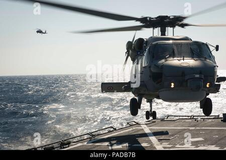 160328-N-FQ994-138 MEDITERRANEAN SEA (March 28, 2016) A Turkish Navy S-70B Seahawk lands aboard USS Porter (DDG 78) March 28, 2016. Porter, an Arleigh Burke-class guided-missile destroyer, forward-deployed to Rota, Spain, is conducting a routine patrol in the U.S. 6th Fleet area of operations in support of U.S. national security interests in Europe. (U.S. Navy Photo by Mass Communication Specialist 3rd Class Robert S. Price/Released) - Stock Photo
