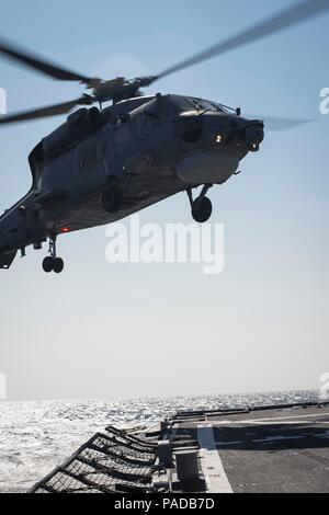 160328-N-FQ994-276 MEDITERRANEAN SEA (March 28, 2016) A Turkish Navy S-70B Seahawk lands aboard USS Porter (DDG 78) March 28, 2016. Porter, an Arleigh Burke-class guided-missile destroyer, forward-deployed to Rota, Spain, is conducting a routine patrol in the U.S. 6th Fleet area of operations in support of U.S. national security interests in Europe. (U.S. Navy Photo by Mass Communication Specialist 3rd Class Robert S. Price/Released) - Stock Photo