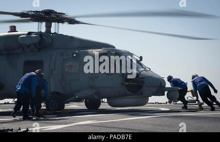 160328-N-FQ994-313 MEDITERRANEAN SEA (March 28, 2016) Sailors aboard USS Porter (DDG 78) secure a Turkish Navy S-70B Seahawk with chocks and chains March 28, 2016.  Porter, an Arleigh Burke-class guided-missile destroyer, forward-deployed to Rota, Spain, is conducting a routine patrol in the U.S. 6th Fleet area of operations in support of U.S. national security interests in Europe. (U.S. Navy Photo by Mass Communication Specialist 3rd Class Robert S. Price/Released) - Stock Photo