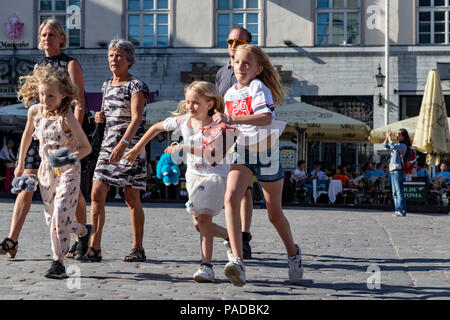 Tourists in Tallin, Estonia - Stock Photo