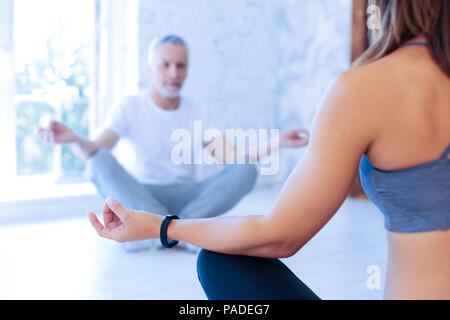 Silhouette of elderly man that doing yoga - Stock Photo