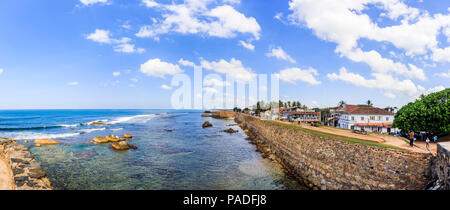 Ramparts and sea wall, Galle Fort viewed from the Flagrock Bastion, Galle, Southern Province, Sri Lanka, blue sea and sky and coastline on a sunny day - Stock Photo