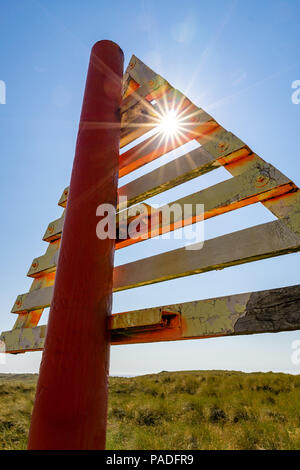 These Signs (German: Bake) on the Ellenbogen Beach mark the border between Germany and Denmark in the Wadden Sea. - Stock Photo