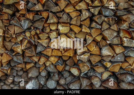 Closeup of a pile of firewood stacked ready for the winter image with copy space - Stock Photo