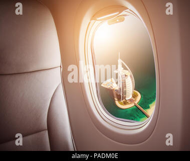DUBAI, UAE - MARCH 2018: Aerial view of Burj Al Arab hotel in Dubai, one of the most luxury hotel in the world. Concept of travel and air transportati - Stock Photo