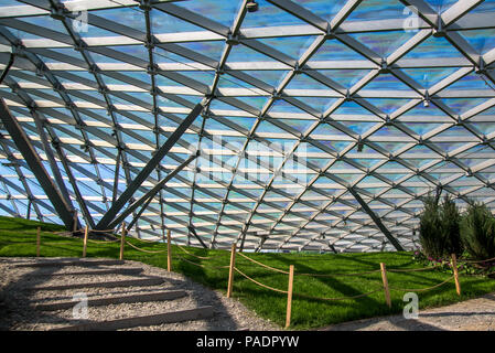 Moscow, Russia, May 13, 2018 Zaryadye park in the center of Moscow. Triangular pattern of transparent glass modern roof - Stock Photo