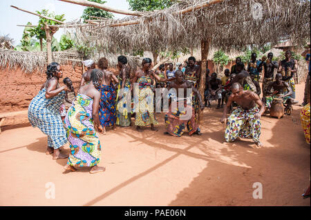 KARA, TOGO - MAR 11, 2012:  Unidentified Togolese people dance  the religious voodoo dance. Voodoo is the West African religion - Stock Photo