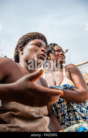 KARA, TOGO - MAR 11, 2012:  Unidentified Togolese woman dances the religious voodoo dance. Voodoo is the West African religion - Stock Photo