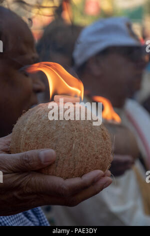 Flaming coconut during the ceremony at Ratha Yatra on Stephen Avenue, Downtown Calgary, Alberta, Canada. - Stock Photo