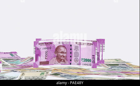 2000 rupees new notes Indian currency front view on the stack of 500, 200, 2000 rupee Indian currencies on background stock image - Stock Photo