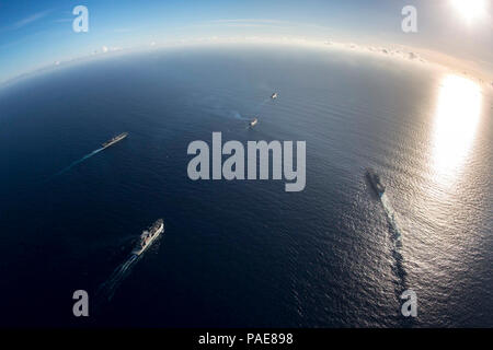 CARIBBEAN SEA (Sept. 19, 2017) The dry cargo and ammunition ship USNS William McLean (T-AKE 12), the amphibious assault ships USS Kearsarge (LHD 3) and USS Wasp (LHD 1), the aviation logistics container ship SS Wright (T-AVB-3), and the amphibious dock landing ship USS Oak Hill (LSD 51), transit the Caribbean Sea. Kearsarge, Wasp, Oak Hill, McLean, and Wright are assisting with relief efforts in the aftermath of Hurricane Irma. The Department of Defense is supporting the Federal Emergency Management Agency, the lead federal agency in helping those affected by Hurricane Irma to minimize sufferi - Stock Photo