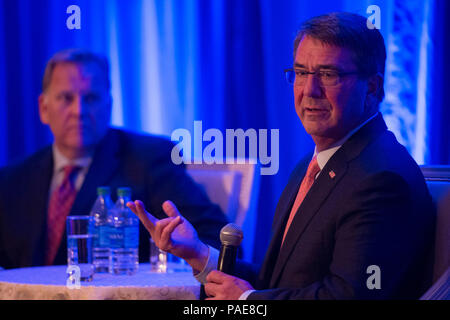 Secretary of Defense Ash Carter answers questions during a fireside chat with Mike Rogers during the Center for the Study of the Presidency and Congress Eisenhower award dinner where he was awarded the Eisenhower Award for leadership in national security affairs March 23, 2016. (DoD photo by Senior Master Sgt. Adrian Cadiz)(Released) - Stock Photo