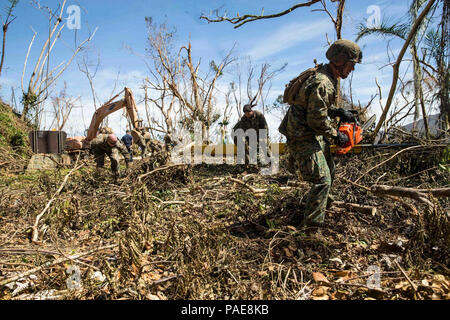 170925-M-CA957-0014 CEIBA, Puerto Rico (Sept. 25, 2017) U.S. Marines assigned to Battalion Landing Team, 2nd Battalion, 6th Marine Regiment, 26th Marine Expeditionary Unit (26th MEU), conduct route clearing operations with Navy Sailors and local civilians to assist in relief efforts for victims of Hurricane Maria in Ceiba, Puerto Rico, Sept. 25, 2017. The Department of Defense is supporting the Federal Emergency Management Agency, the lead federal agency, in helping those affected by Hurricane Maria to minimize suffering and is one component of the overall whole-of-government response effort.