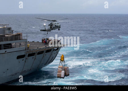 CARIBBEAN SEA (Sept. 28, 2017) Pallets of supplies are transferred from the fast combat support ship USNS Supply (T-AOE 6) to the amphibious assault ship USS Kearsarge (LHD 3) during a replenishment-at-sea for continuing operations in Puerto Rico. Kearsarge is assisting with relief efforts in the aftermath of Hurricane Maria. The Department of Defense is supporting the Federal Emergency Management Agency, the lead federal agency, in helping those affected by Hurricane Maria to minimize suffering and is one component of the overall whole-of-government response effort. - Stock Photo