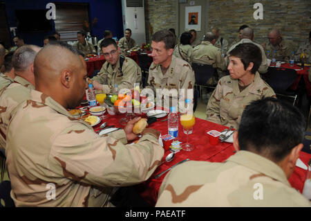 KANDAHAR AIRFIELD, Afghanistan- Vice Admiral Dirk J. Debbink, Chief of Naval Reserve, enjoys breakfast with Sailors from Naval Construction Regiment 22.  He is visiting Sailors and Marines overseas with Honorable Juan M. Garcia III, the Assistant Secretary of the Navy for Manpower and Reserve Affairs, to personally thank them for their service, and highlight the wide range of personnel programs covered in the 21st Century Sailor and Marine initiative.  The initiative consolidates a set of objectives and policies, new and existing, to maximize Sailor and Marine personal readiness, build resilie - Stock Photo