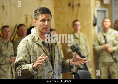 KANDAHAR AIRFIELD, Afghanistan- Honorable Juan M. Garcia III, the Assistant Secretary of the Navy for Manpower and Reserve Affairs, and Vice Admiral Dirk J. Debbink, Chief of Naval Reserve, visited Sailors from Naval Construction Regiment 22 and Naval Mobile Construction Battalion 7.  The leaders are visiting Sailors and Marines overseas to personally thank them for their service, and highlight the wide range of personnel programs covered in the 21st Century Sailor and Marine initiative.  The initiative consolidates a set of objectives and policies, new and existing, to maximize Sailor and Mar - Stock Photo