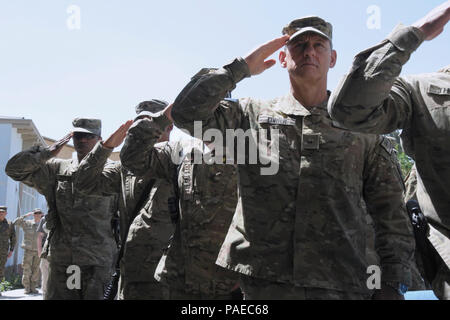 KABUL, Afghanistan - (June 14, 2012) American and coalition service members assigned to NATO Training Mission-Afghanistan (NTM-A) salute during the Afghan and U.S. national anthems at the 237th United States Army Birthday celebration aboard Camp Eggers, Kabul Afghanistan, June 14. NTM-A is a coalition of 38 troop-contributing nations charged with assisting the Government of the Islamic Republic of Afghanistan in generating a capable and sustainable Afghan National Security Force ready to take lead of their country's security by 2014. For more information about NTM-A, visit - Stock Photo