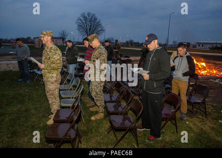 U.S. Service members give praise by song during an Easter sunrise worship service aboard Mihail Kognalniceanu Air Base, Romania, March 27, 2016. Christians around the world celebrated Easter and the resurrection of Jesus Christ. (U.S. Marine Corps photo by Cpl. Kelly L. Street, 2D MARDIV COMCAM/Released) - Stock Photo