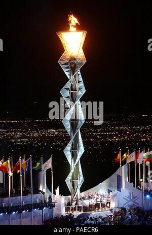 Lake City, UT (Feb. 8, 2002) -- Members of the 1980 Gold Medal U.S. Olympic hockey team stand below the Olympic flame after lighting it at Rice-Eccles Olympic Stadium during the opening ceremonies of the 2002 Winter Olympics in Salt Lake City.  The team had the honor of lighting the cauldron to invoke the official start of the competition.  U.S. Navy - Stock Photo