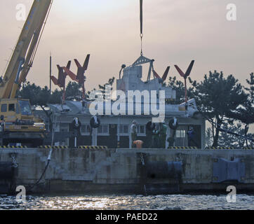 160329-N-CW500-012 POHANG, Republic of Korea (March 29, 2016) Sailors assigned to Helicopter Mine Countermeasures Squadron (HM) 14 Detachment 2A  lower a MK Magnetic Minesweeping System into the water via crane during Foal Eagle. Foal Eagle is a series of joint and combined field training exercises conducted by Combined Forces Command (CFC) and U.S. Forces Korea (USFK) ground, air, naval and special operations component commands. (U.S. Navy photo by Lt. Cmdr. Kevin Jane/RELEASED) - Stock Photo