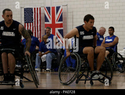 Team Navy/Coast Guard member retired Aviation Electrician's Mate Steven Davis of Turlock, Calif., and retired Operations Specialist 2nd Class Joseph Frank, of San Diego, Calif., block opposing team members in a wheelchair basketball game against Team Air Force during the 2013 Warrior Games May 14. The Warrior Games includes competitions in archery, cycling, seated volleyball, shooting, swimming, track and field, and wheelchair basketball. The goal of the Warrior Games is not necessarily to identify the most skilled athletes, but rather to demonstrate the incredible potential of wounded warrior - Stock Photo