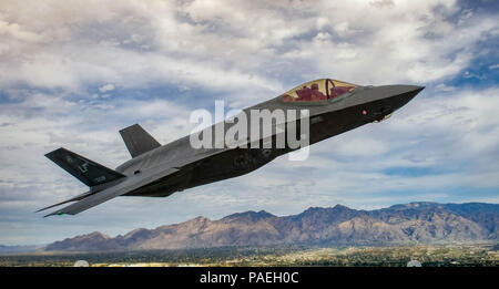 An F-35 Lightening II flies around the airspace of Davis-Monthan Air Force Base on March 5, 2016. The F-35 was participating in Air Combat Command's Heritage Flight Training Course, a program that features modern fighter/attack aircraft flying alongside Word War II, Korean War, and Vietnam War-era aircraft. (U.S. Air Force photo by Tech. Sgt. Brandon Shapiro) - Stock Photo