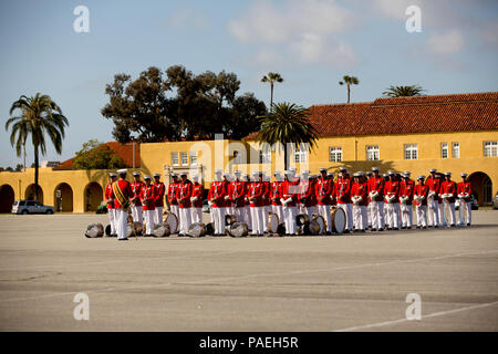 U.S. Marines with Marine Drum and Bugle Corps, Battle Color Detachment, Marine Barracks Washington, D.C., stand in a formation at Marine Corps Recruit Depot San Diego, Calif., March 12, 2016. After their performance, the Marines marched aside to make room for the next portion of the Battle Color ceremony. (U.S. Marine Corps photo by Cpl. Bethanie C. Sahms/Released) - Stock Photo