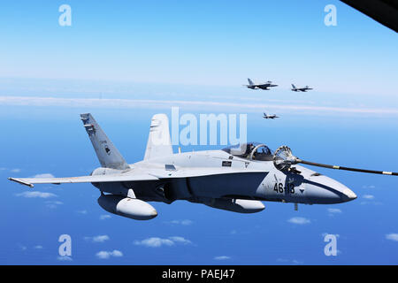 Spanish Air Force F/A-18 Hornets with 462 Squadron fly in formation during an air-to-air refuel mission with a U.S. Marine Corps KC-130J with Marine Aerial Refueler Transport Squadron 252, Special-Purpose Marine Air-Ground Task Force-Crisis Response- Africa, Gran Canaria, Spain, Mar. 29, 2016. SPMAGTF-CR-AF Marines and Spanish airmen conducted air-to-air refueling missions in order to enhance crisis response readiness and help build relationships between the two militaries. (U.S. Marine Corps photo by Sgt. Kassie L. McDole/Released) - Stock Photo