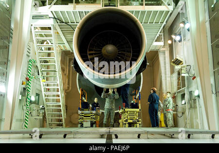 Personnel assigned to the 436th Maintenance Squadron Jet Engine Test Cell perform maintenance on a General Electric TF39 high bypass turbofan engine March 17, 2016, on Dover Air Force Base, Del. This engine, serial number 441052, was the 5,601st and last TF39 to be tested in the test cell. (U.S. Air Force photo/Roland Balik) - Stock Photo