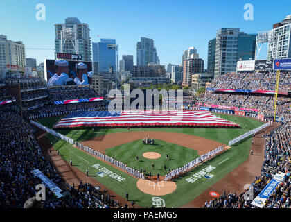 DIEGO (July 12, 2016) Sailors man the rails while Marines hold up the American flag during the pre-game ceremony of the 2016 Major League Baseball All-Star Game at Petco Park. Sailors from the aircraft carrier USS Theodore Roosevelt (CVN 71) and Marines from the 3rd Marine Aircraft Wing joined together to participate in a salute to the United States Armed Forces. Stock Photo