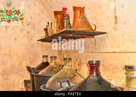 Wine demijohns in Moravian wine cellar.  Full carboys of wine. Jimmyjohns in wine cellar. - Stock Photo