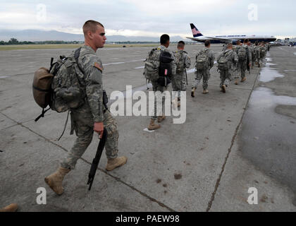 U.S. Soldiers from the 82nd Airborne Division prepare to return to Fort Bragg, N.C., March 6, 2010, after providing disaster assistance and humanitarian relief during Operation Unified Response in Port-au-Prince, Haiti. The 82nd Airborne managed food and shelter distribution and rubble removal, among other tasks. - Stock Photo
