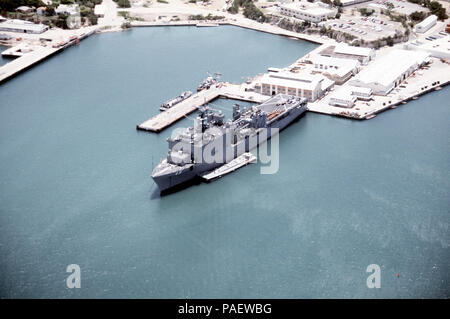 An overhead, port bow view of the dock landing ship USS ASHLAND (LSD-48) Med-moored in port.  The ASHLAND is taking on supplies destined for Florida communities devastated by Hurricane Andrew as part of Operation Help From the Sea. - Stock Photo