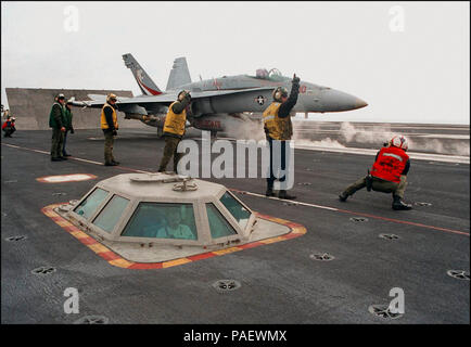 - Crewmembers line the flight deck of U.S. Navy's nuclear powered aircraft carrier USS George Washington (CVN 73) in preparation for the launch of an FA-18C 'Hornet' assigned to the ТWildcatsУ of Fighter Attack Squadron One Three One (VFA-131), February 17, 1996. Washington, commanded by CAPT Malcolm P. Branch, is currently on a scheduled six-month deployment to the Mediterranean, and has been operating in the Adriatic Sea in support of the NATO-led Operation Joint Endeavor. U.S. Navy - Stock Photo
