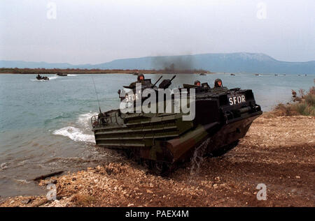 of a long line of U.S. Marine Assault Amphibious Vehicles from the 26th Marine Expeditionary Unit comes ashore at Port Ploce, Croatia, on March 24, 1998.  Assigned to the Strategic Reserve Force of the Stabilization Force, the Marines are taking part in Exercise Dynamic Response 98, a training exercise designed to familiarize the reserve forces with the territory and their operational capabilities within this region.  DoD - Stock Photo
