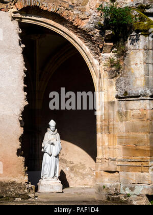Statue de St Mayeul in cloister of Saint Pierre and Saint Paul priory chuch, Souvigny, Allier, Auvergne-Rhone-Alpes,  France - Stock Photo