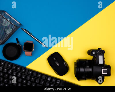 Keyboard, camera, mouse, watch, pen, jammed paper - Stock Photo