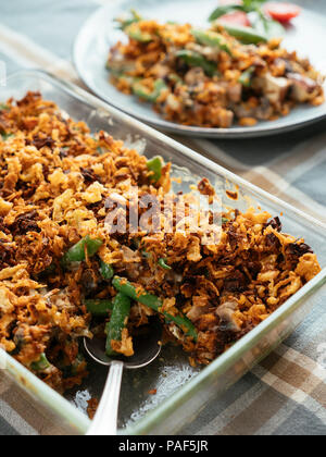 Vegan Green Bean Casserole with Smoked Tofu. Ingredients: green beans, mushrooms, onion, smoked tofu pieces, non-dairy yogurt, dried fried onions, veg - Stock Photo